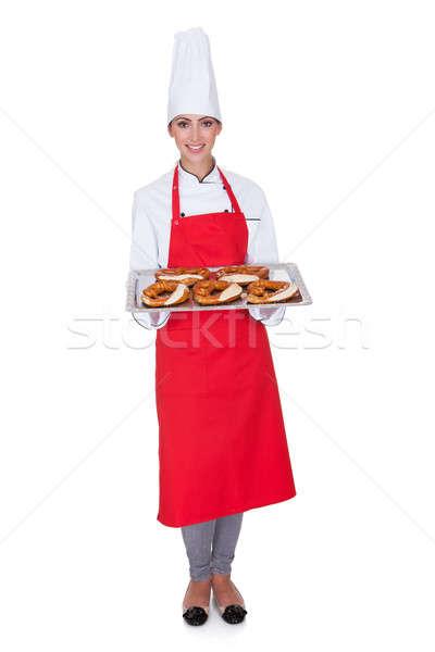 Female Baker Holding Fresh Bavarian Pretzel Stock photo © AndreyPopov