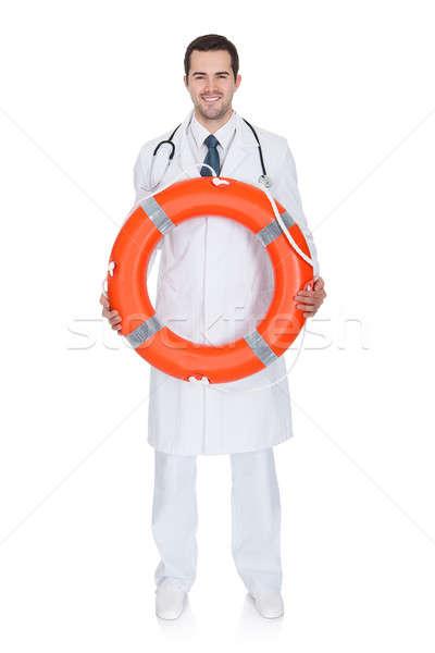 Glimlachend mannelijke arts redding ring geïsoleerd Stockfoto © AndreyPopov