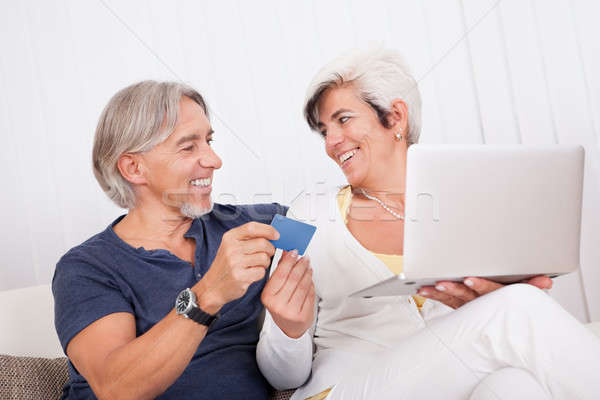 Happy couple making an online purchase Stock photo © AndreyPopov