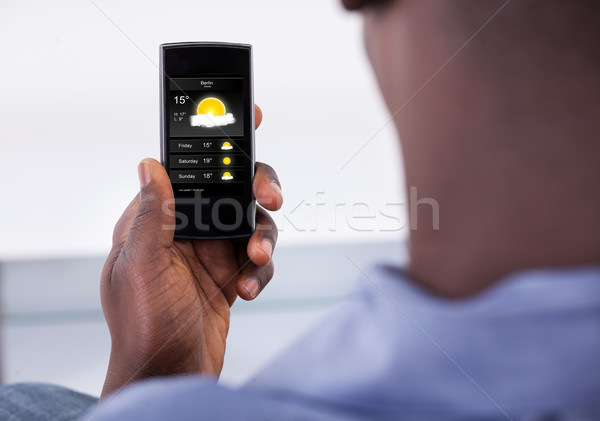 Person Holding Mobile Phone Stock photo © AndreyPopov