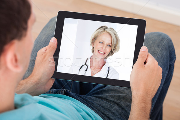 Man Having Video Chat With Female Doctor Stock photo © AndreyPopov