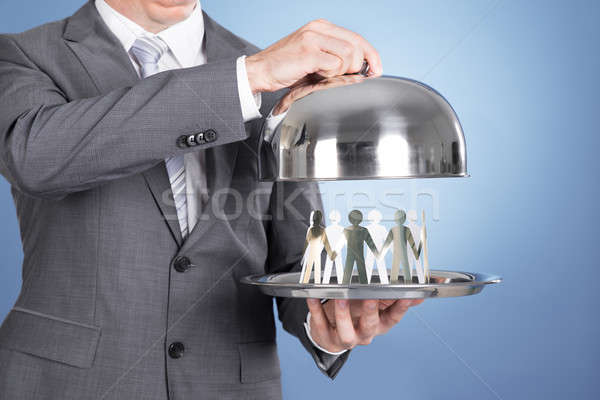 Butler holding tray and paper people Stock photo © AndreyPopov
