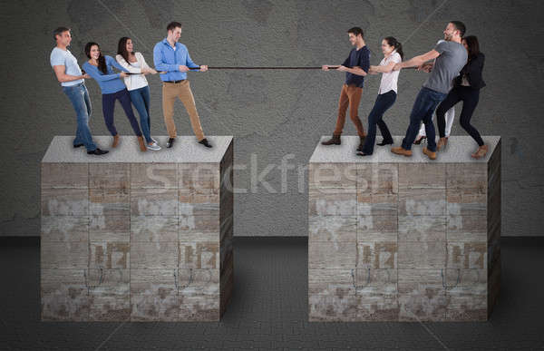Friends Playing Tug-Of-War On Blocks Stock photo © AndreyPopov