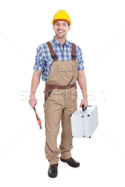 Confident Young Male Worker With Wrench And Toolbox Stock photo © AndreyPopov
