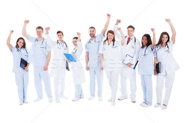 Successful medical team standing cheering Stock photo © AndreyPopov