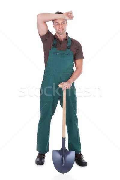 Masculino jardineiro retrato cansado pá branco Foto stock © AndreyPopov