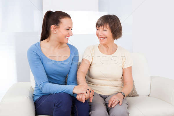 Caregiver Consoling Senior Woman Stock photo © AndreyPopov