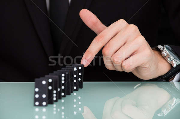 Businessman Playing Domino Stock photo © AndreyPopov