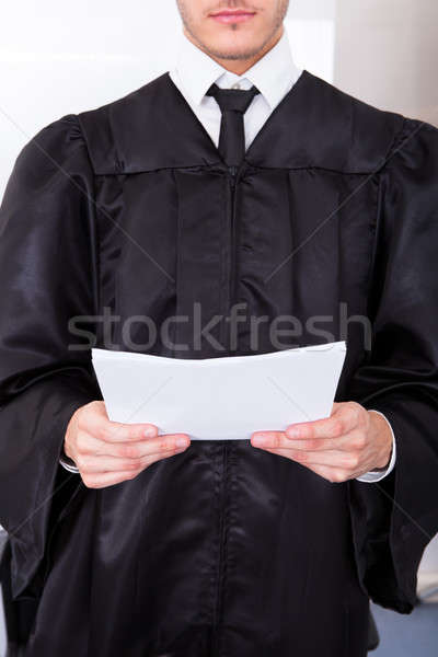 Homme juge documents robe Photo stock © AndreyPopov