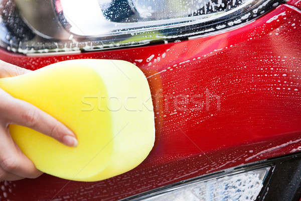 Main lavage rouge voiture jaune éponge Photo stock © AndreyPopov