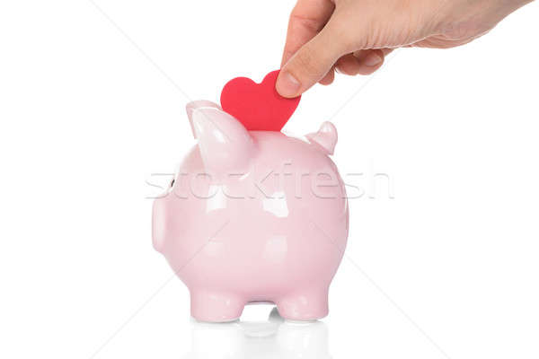 Hand Deposit Red Heart In Piggy Bank Stock photo © AndreyPopov