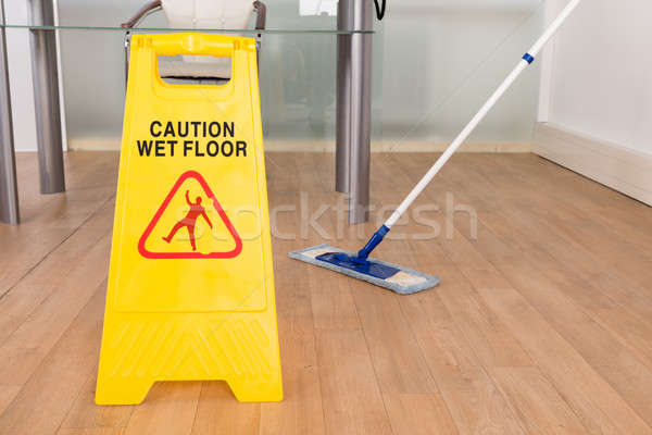 Wet Floor Sign And Mop Stock photo © AndreyPopov