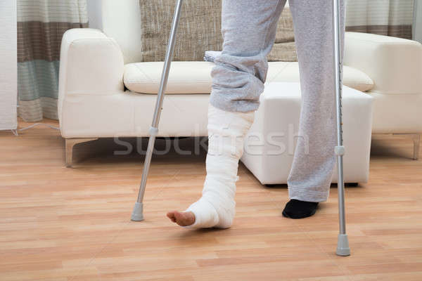 Man Using Crutches For Walking Stock photo © AndreyPopov