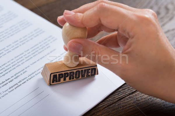 Person Hands Using Stamper On Document Stock photo © AndreyPopov