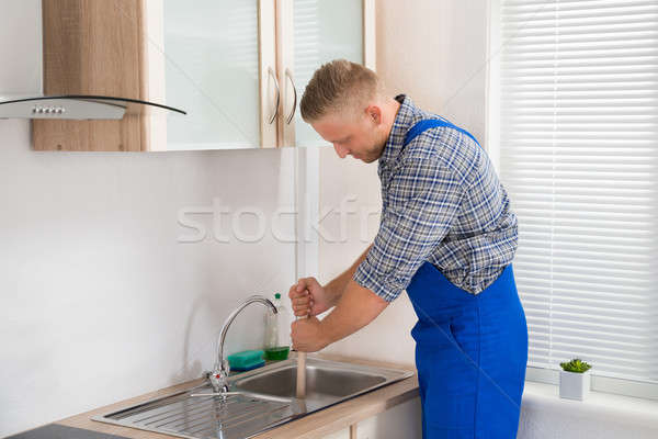 Plumber Using Plunger In Sink Stock photo © AndreyPopov