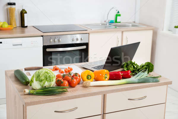 Vegetables With Laptop On A Countertop Stock photo © AndreyPopov