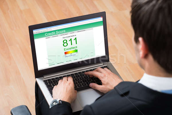 Stock photo: Businessperson Checking Online Credit Score Record On Laptop