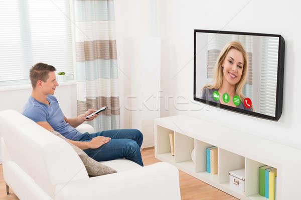 Man Video Chatting using Television Stock photo © AndreyPopov