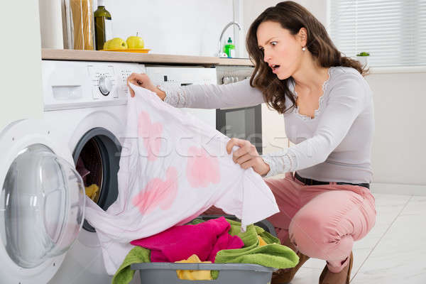 Woman Looking At Stained Cloth Stock photo © AndreyPopov