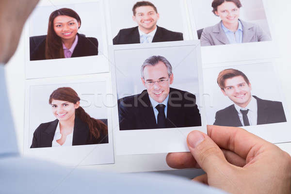 Businessperson Choosing Photograph Of Best Candidate Stock photo © AndreyPopov