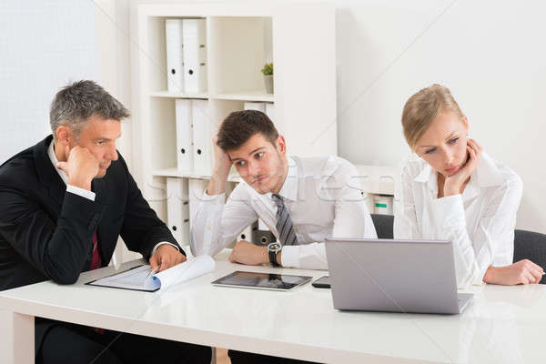 Businesspeople Getting Bored In Office Stock photo © AndreyPopov