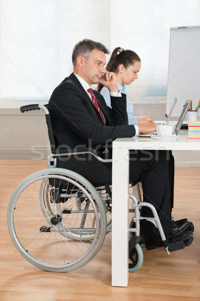 özürlü işadamı işkadını konferans salonu olgun oturma Stok fotoğraf © AndreyPopov