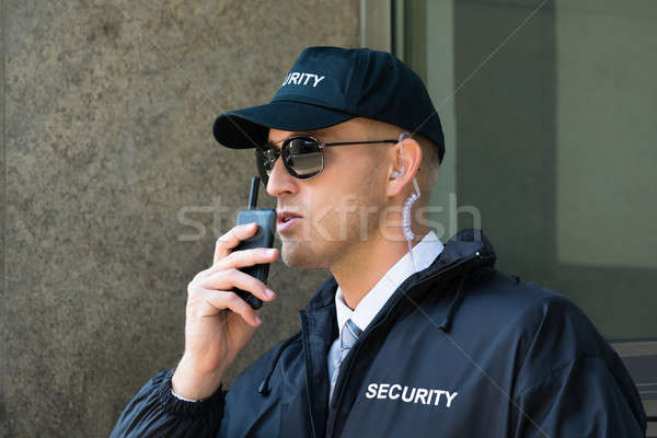 Security Guard Using Walkie-talkie Radio Stock photo © AndreyPopov