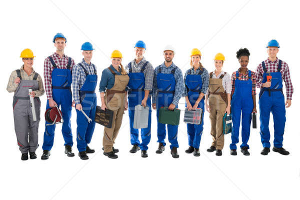 Portrait Of Confident Carpenters Carrying Toolboxes Stock photo © AndreyPopov