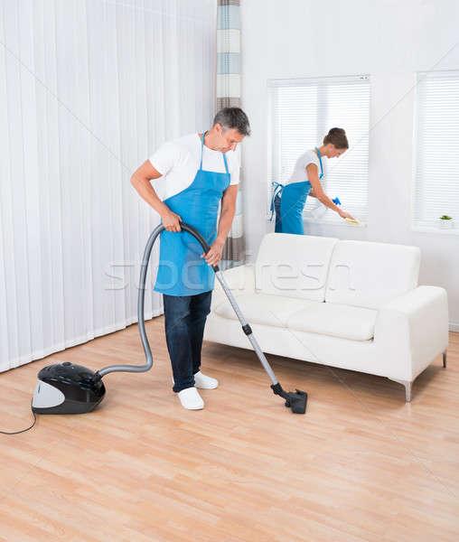 Twee schoonmaken kantoor uniform woonkamer huis Stockfoto © AndreyPopov