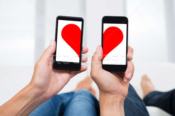 Iki kişi kalp şekli eller Stok fotoğraf © AndreyPopov