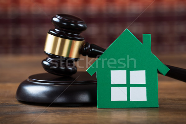 Mallet With Green Paper House In Courtroom Stock photo © AndreyPopov