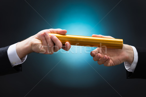 Businessman Passing Relay Baton To Colleague Stock photo © AndreyPopov