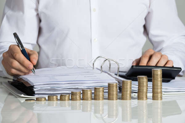 Businessman Calculating Invoice Stock photo © AndreyPopov