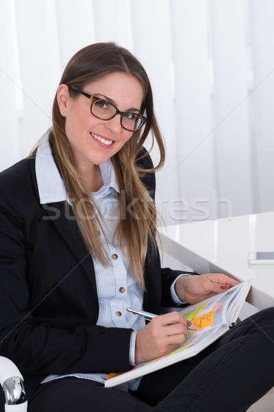 Businesswoman Writing In Diary Stock photo © AndreyPopov