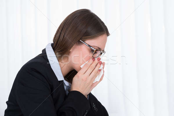 Zakenvrouw blazen neus zakdoek portret jonge schoonheid Stockfoto © AndreyPopov
