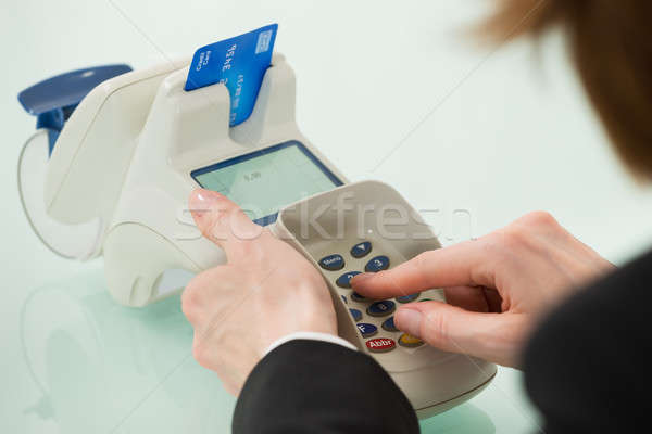 Woman Hand Using Credit Card Machine Stock photo © AndreyPopov