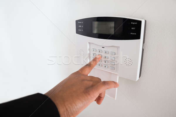 Businesswoman Hand Entering Code In Security System Stock photo © AndreyPopov