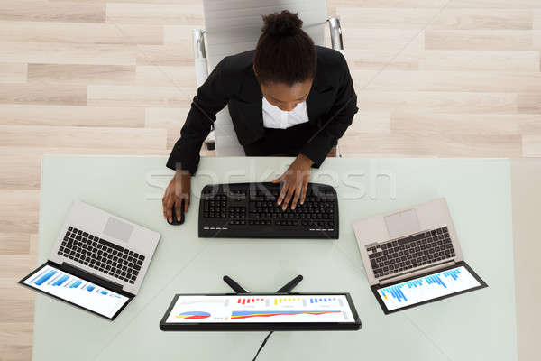 Young African Businesswoman Analyzing Graph Stock photo © AndreyPopov