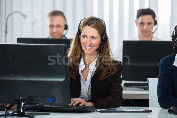 Businesswoman Working With Colleagues In Office Stock photo © AndreyPopov