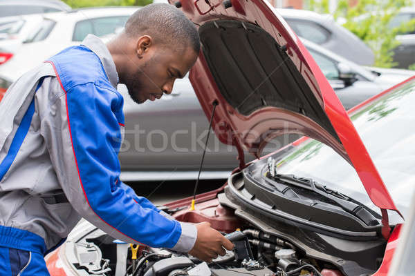 Mechanic Checking Car Battery With Multimeter Stock photo © AndreyPopov