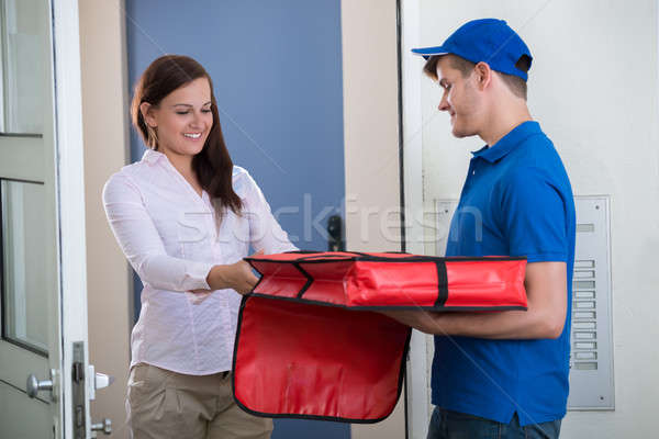 Man Delivering Pizza To Young Woman Stock photo © AndreyPopov