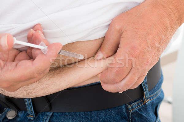 Diabetico uomo stomaco primo piano home medicina Foto d'archivio © AndreyPopov