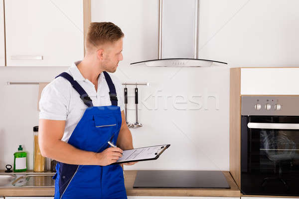 Portrait Of A Technician In Kitchen Stock photo © AndreyPopov