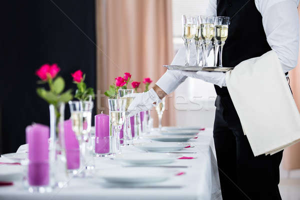Garçon banquet table champagne restaurant Photo stock © AndreyPopov