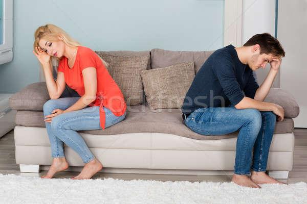 Sad Couple Sitting Back To Back On Sofa Stock photo © AndreyPopov