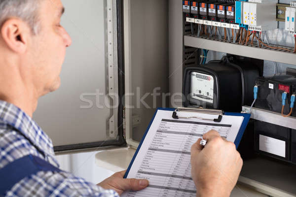 Stock photo: Male Technician Writing Reading Of Meter