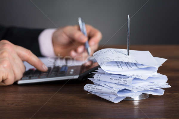 Empresário calculadora secretária Foto stock © AndreyPopov