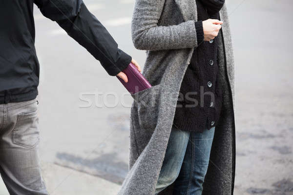 Man Stealing Purse Stock photo © AndreyPopov