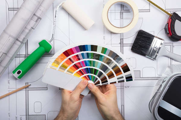 An Architect Holding Color Guide Swatch On Blueprints Stock photo © AndreyPopov
