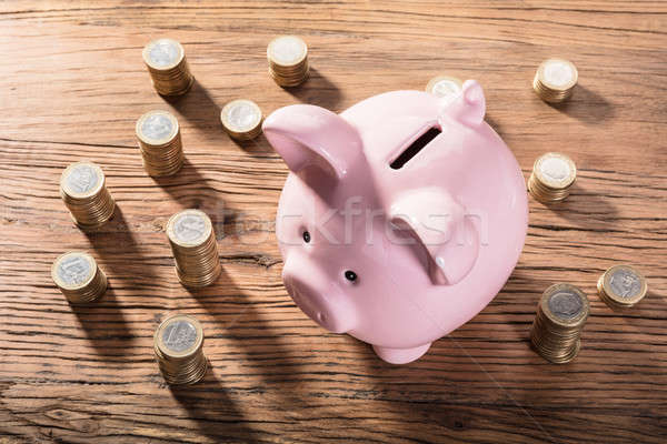 Piggybank Surrounded With Coin Stacks Stock photo © AndreyPopov